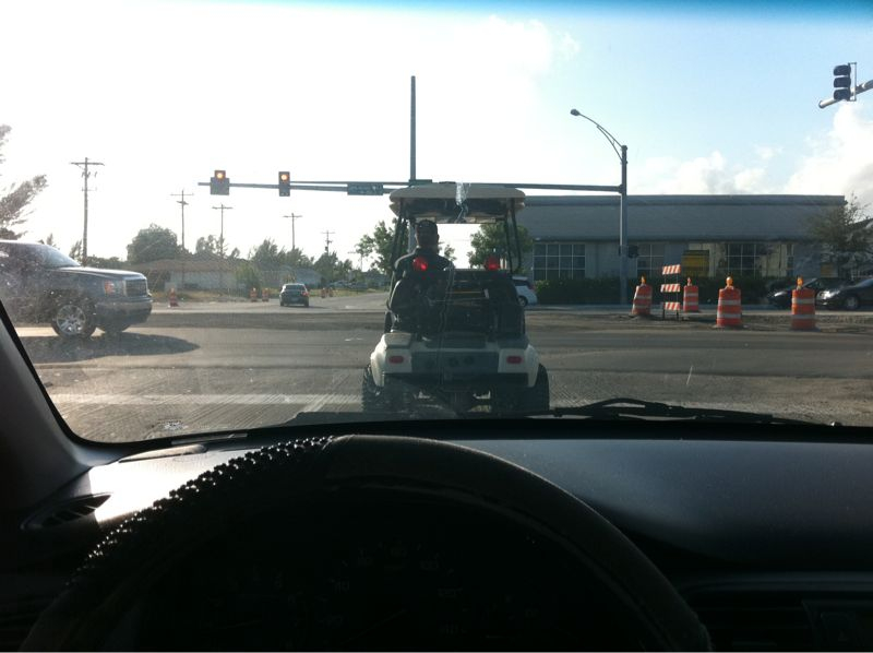 Only in Florida can I get stuck @ light in a major intersection behind a golf cart..