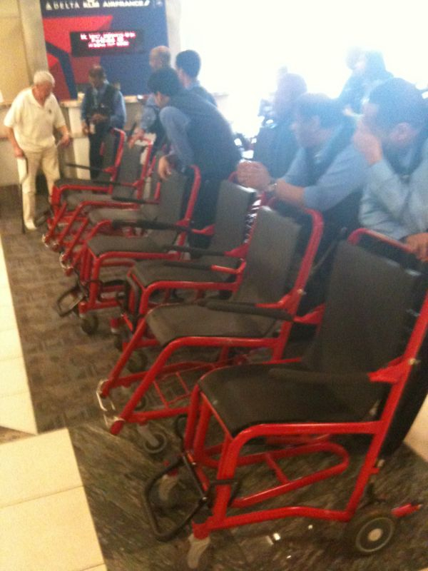 How do i know which airport gate is to ft myers Fl? The locomotive train of wheelchairs parked outside of it.. Gotta love the snowbirds..