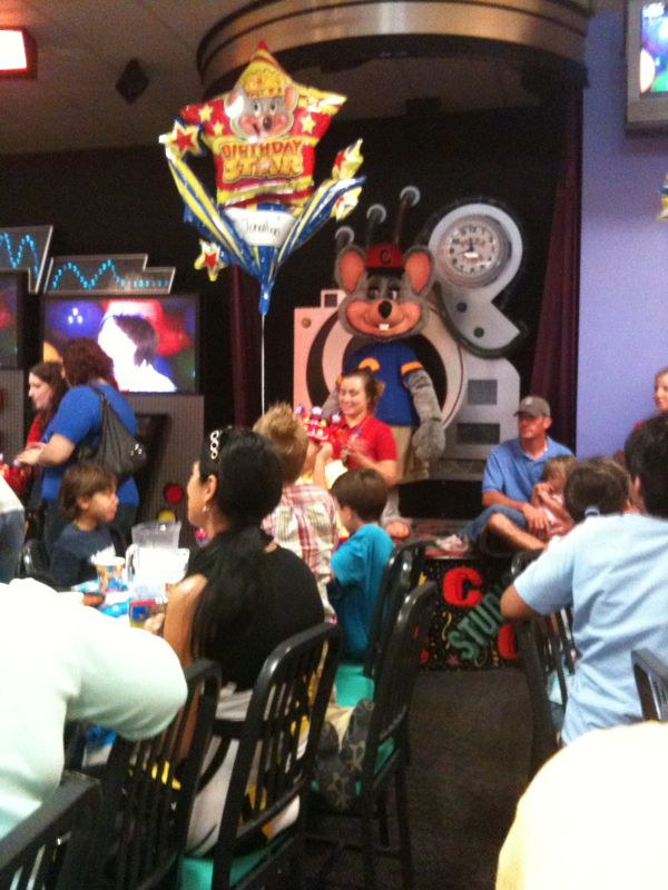 @ a chuck e. Cheese bday pty. And just realized a Lg. Rat is trying to hug my kid.. Where's the orkin man?
