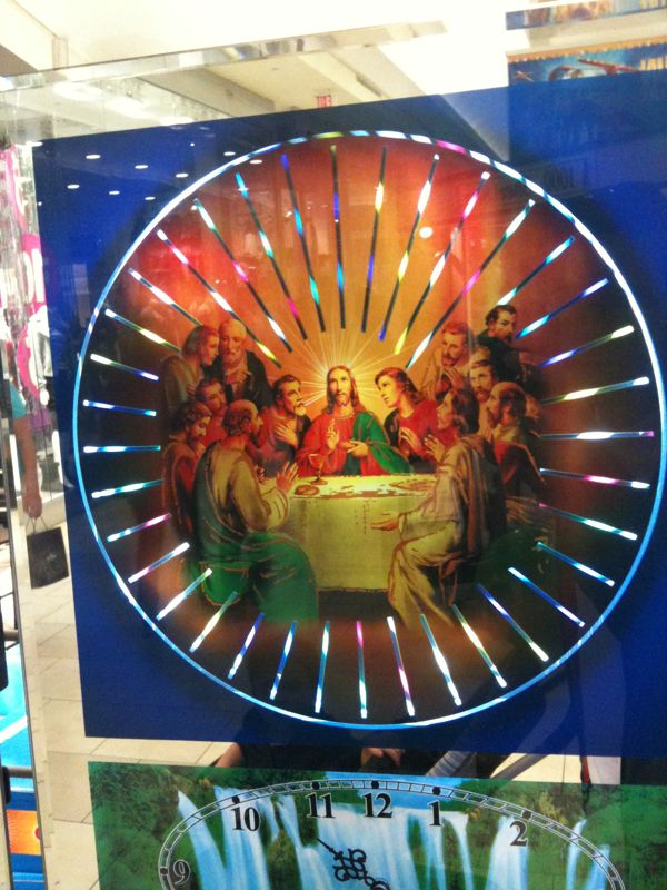 Sorry but this spinning light last supper wall clock is wrong on so many levels.. Don't get me this for Christmas!