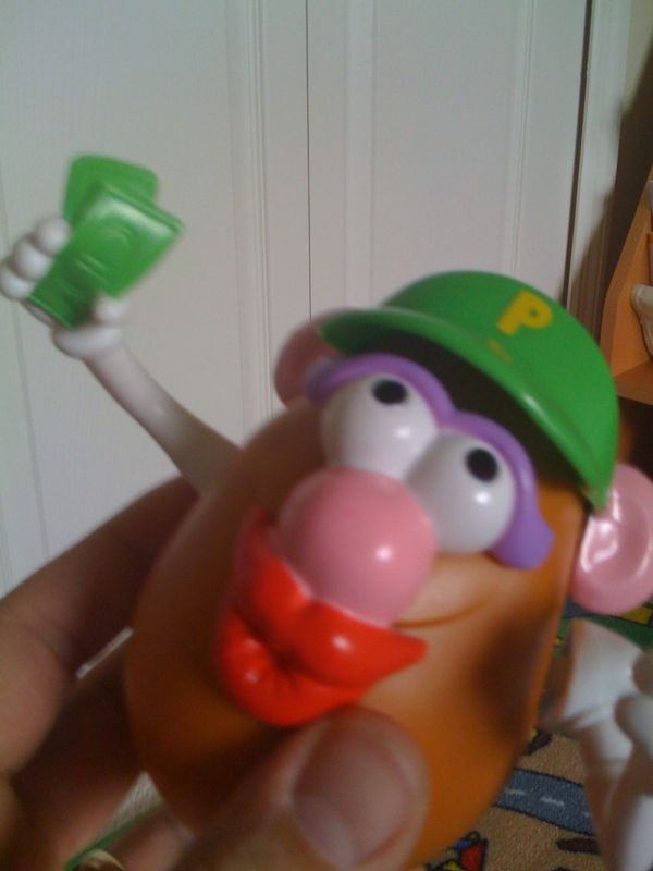 Please explain why mr. Potato head is balling out with cash in his hand? Does he have stacks like that?