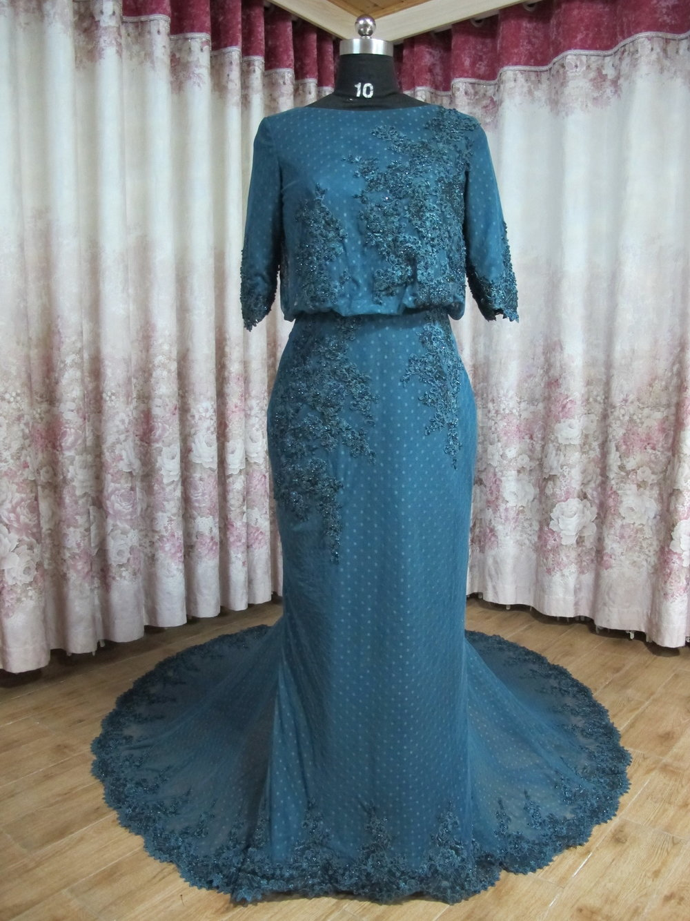 I received the dress and it is so beautiful. I am very satisfied ...