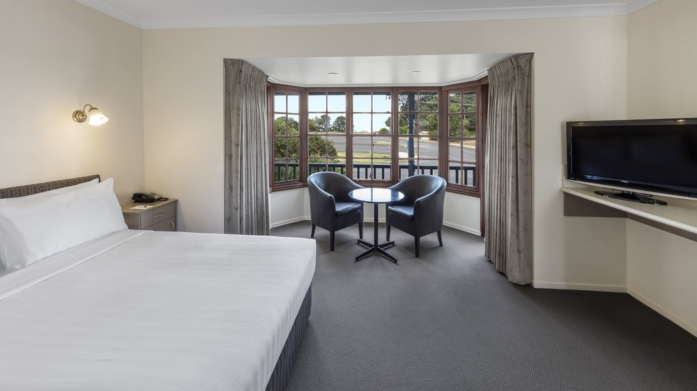 Premium Queen - One of our most popular room types. Beautifully renovated with 1 x queen bed, leather tub chairs and a private ensuite.⨠ View Room Details