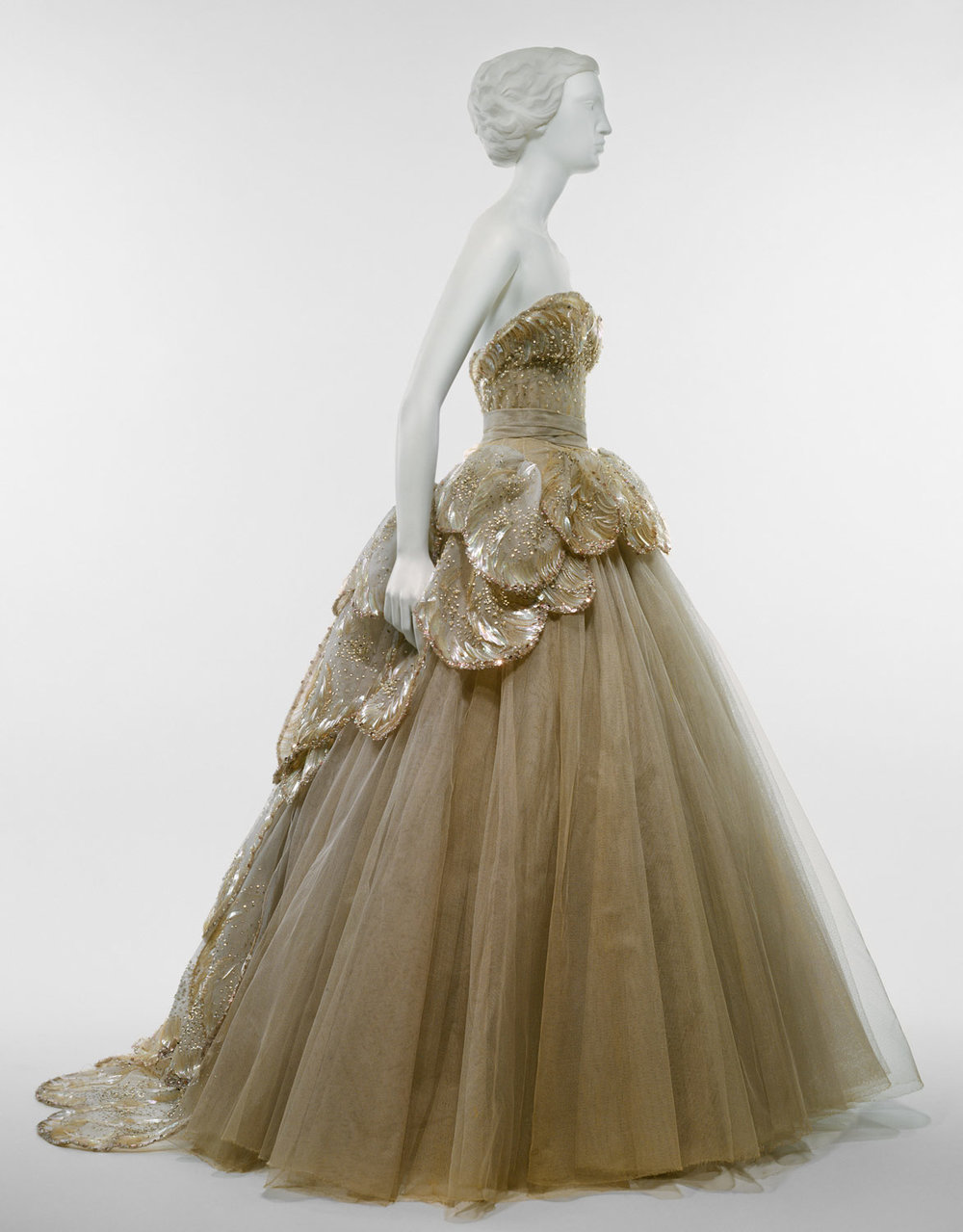 """Venus"" gown at the Metropolitan Museum of Art, Costume Institute     Design House:  House of Dior (French, founded 1947)    Designer:  Christian Dior (French, Granville 1905–1957 Montecatini)    Date:  fall/winter 1949–50   Culture:  French   Medium:  silk, sequins, rhinestones, simulated pearls   Credit Line:  Gift of Mrs. Byron C. Foy, 1953   Accession Number: C.I.53.40.7a–e"