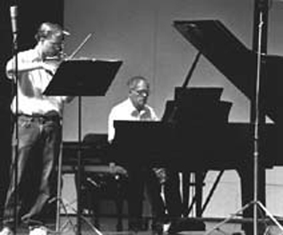 John Owings and Fritz Gearhart. This photo was taken during the actual recording of their CD of unpublished Quincy Porter works at East Carolina University.