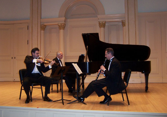 Trio Con Brio members John Owings, Gary Whitman and Misha Galaganov during their performance of the world premiere of his Trio for Clarinet, Viola and Piano at Carnegie Hall's Weill Recital Hall.