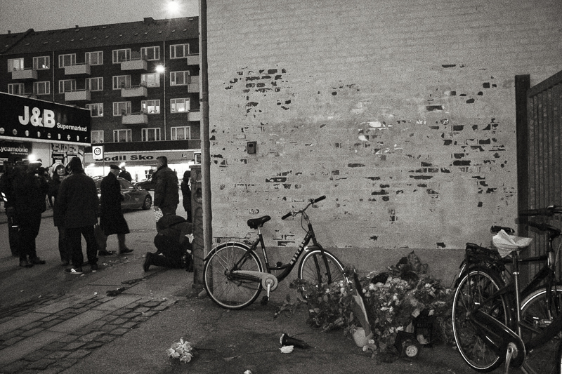 Copenhagen, Denmark- February 16th 2015.  Flowers that citizens of Copenhagen have put for the suspected terrorist had been put in a corner by a group of young men, as they said it's not a muslim tradition to put flowers for the dead. Location: Svanegade 1, in Nørrebro (NordVest-neighbourhood) in Copenhagen, right where the 22 year old Omar Abdel Hamid El-Hussein was shot and killed by the Police.