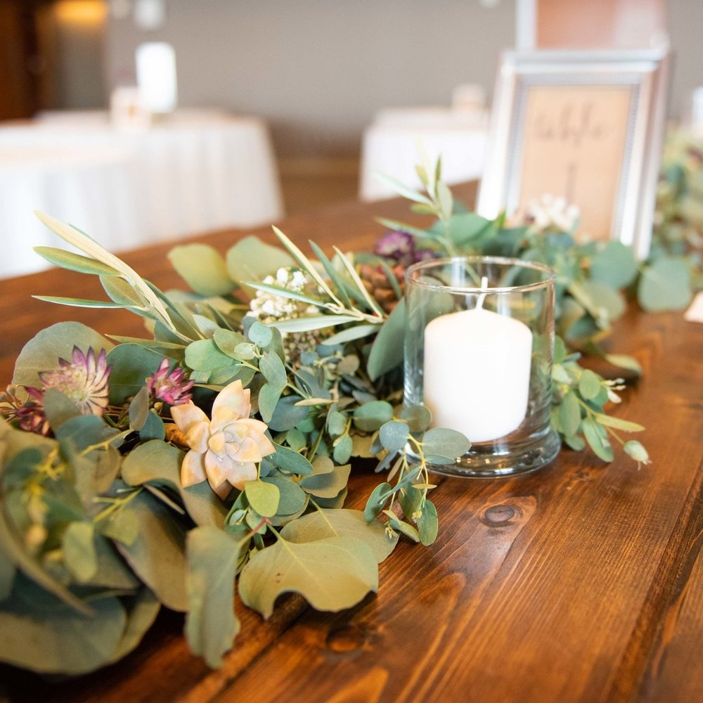 Sustainable weddings and events. Beautiful Eucalyptus garland centerpiece with Olive leaf, Babies Breath and succulents. No water centerpieces for your eco minded event.  Design By: The Potted Poppy, San Diego