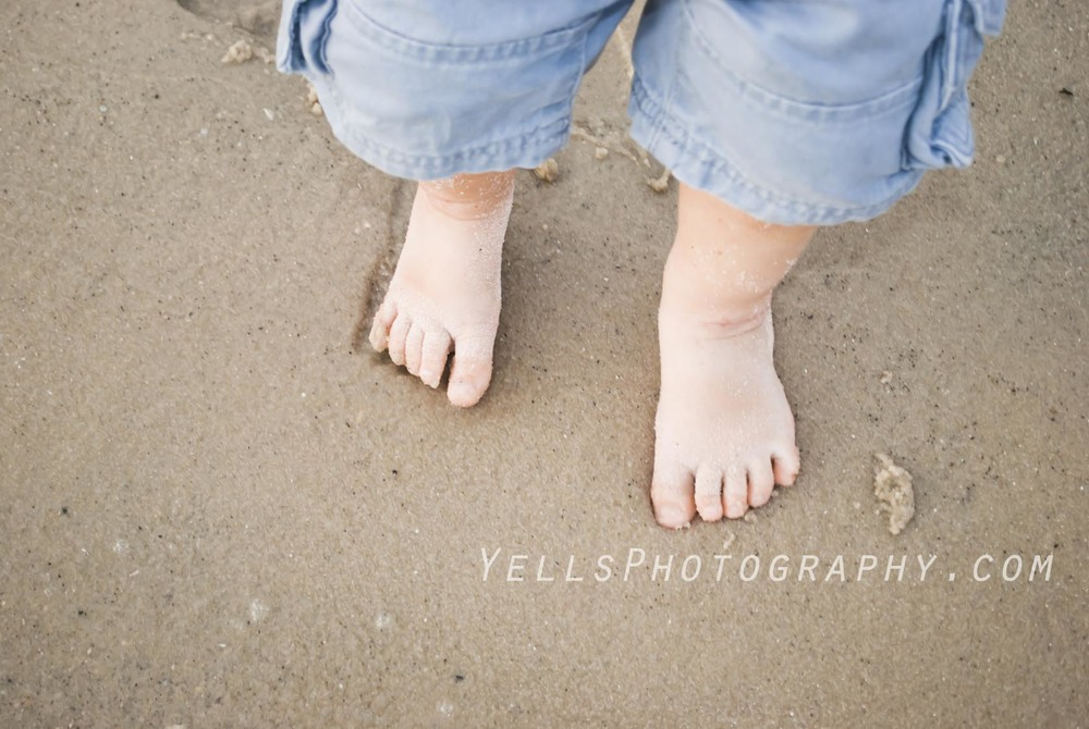 Child Feet in the Sand
