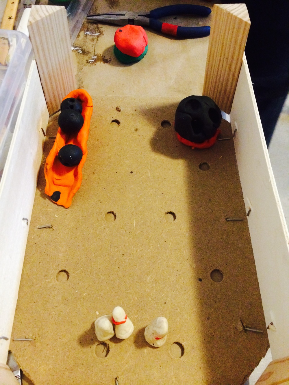 Bowling alley!!!  From an adapted orange crate and plasticine.