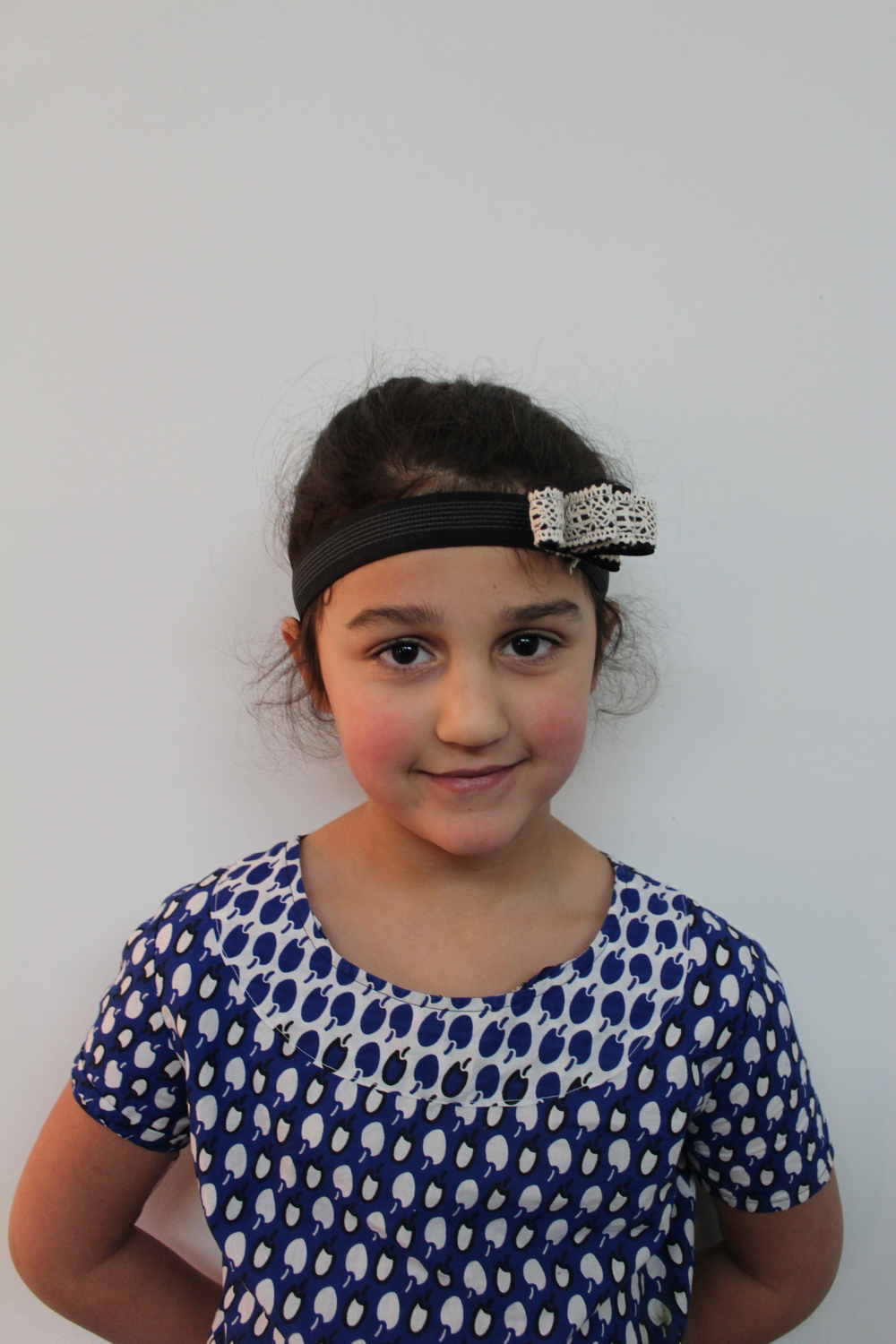 This artist designed and made, with her mom, an awesome headband - lace and elastic!