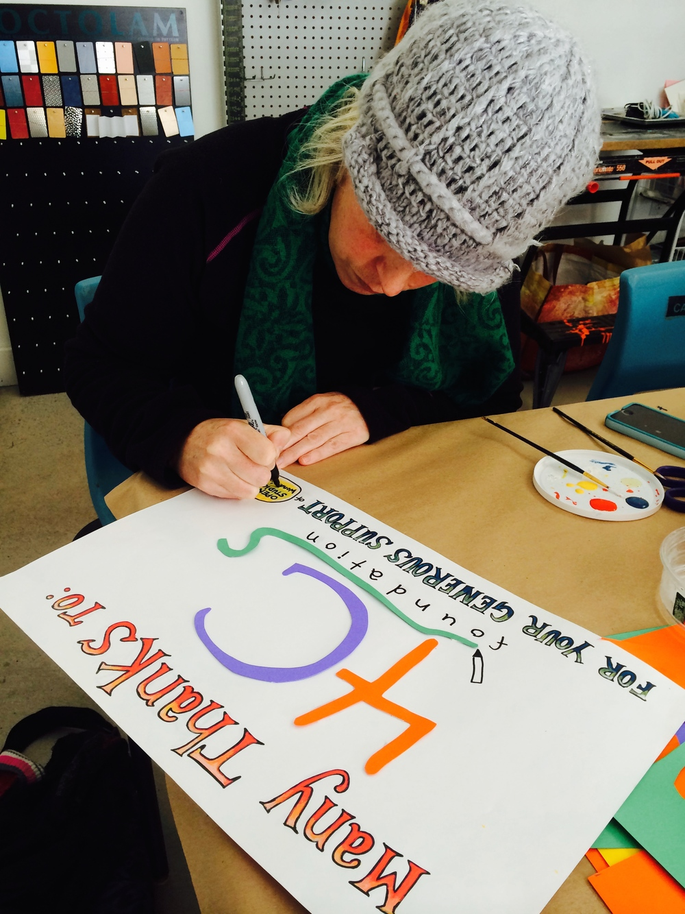 A beautiful sign gets made by our board member, Cecilia.  Thanks to the 4Cs Foundation for their generous support of the Open Studio Pilot Project!