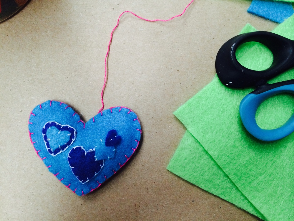 Gorgeous hand-sewn blue heart - beautiful blanket stitch!