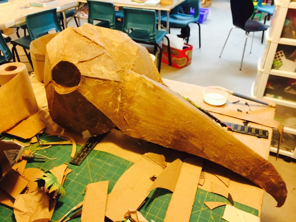 The bird head created from cardboard and papier mache.