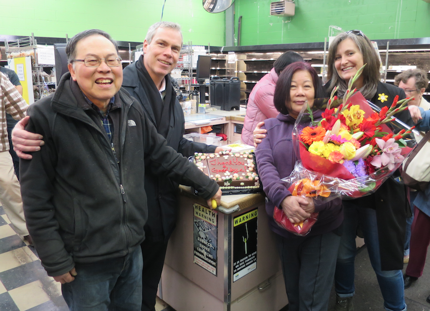 Stephen Regan of the West End BIA and Sheryl Williamson of the West End Citizens Action Network were on hand today to thank Andrew and Fanny Lo for their years of service at West Valley Market.  (Stephen Irving Photos / Courtesy of the West End BIA)