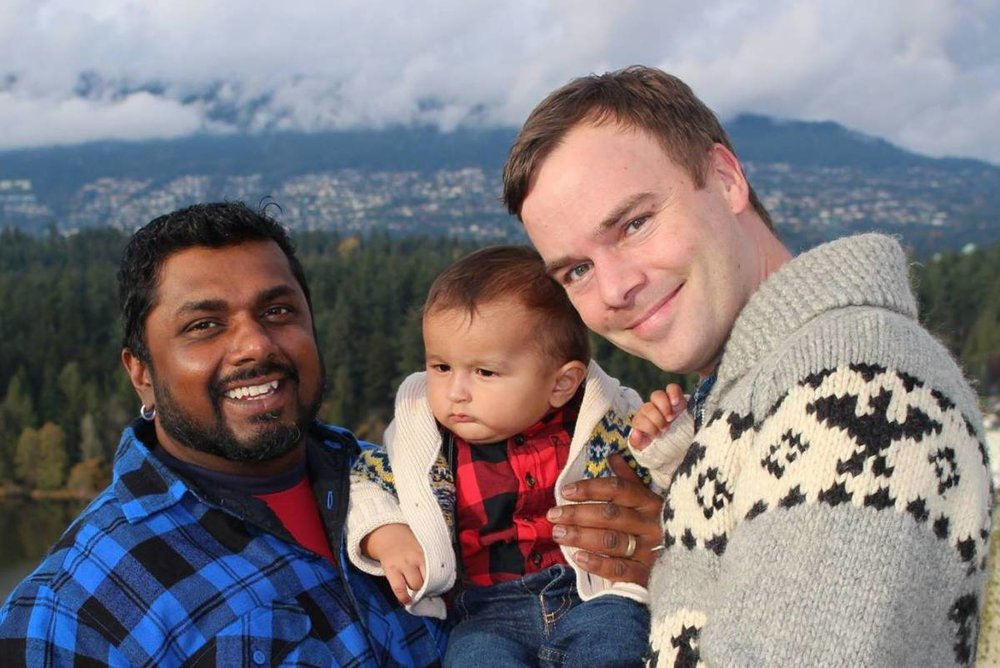 Romi and Spencer Chandra Herbert, with their son Dev.
