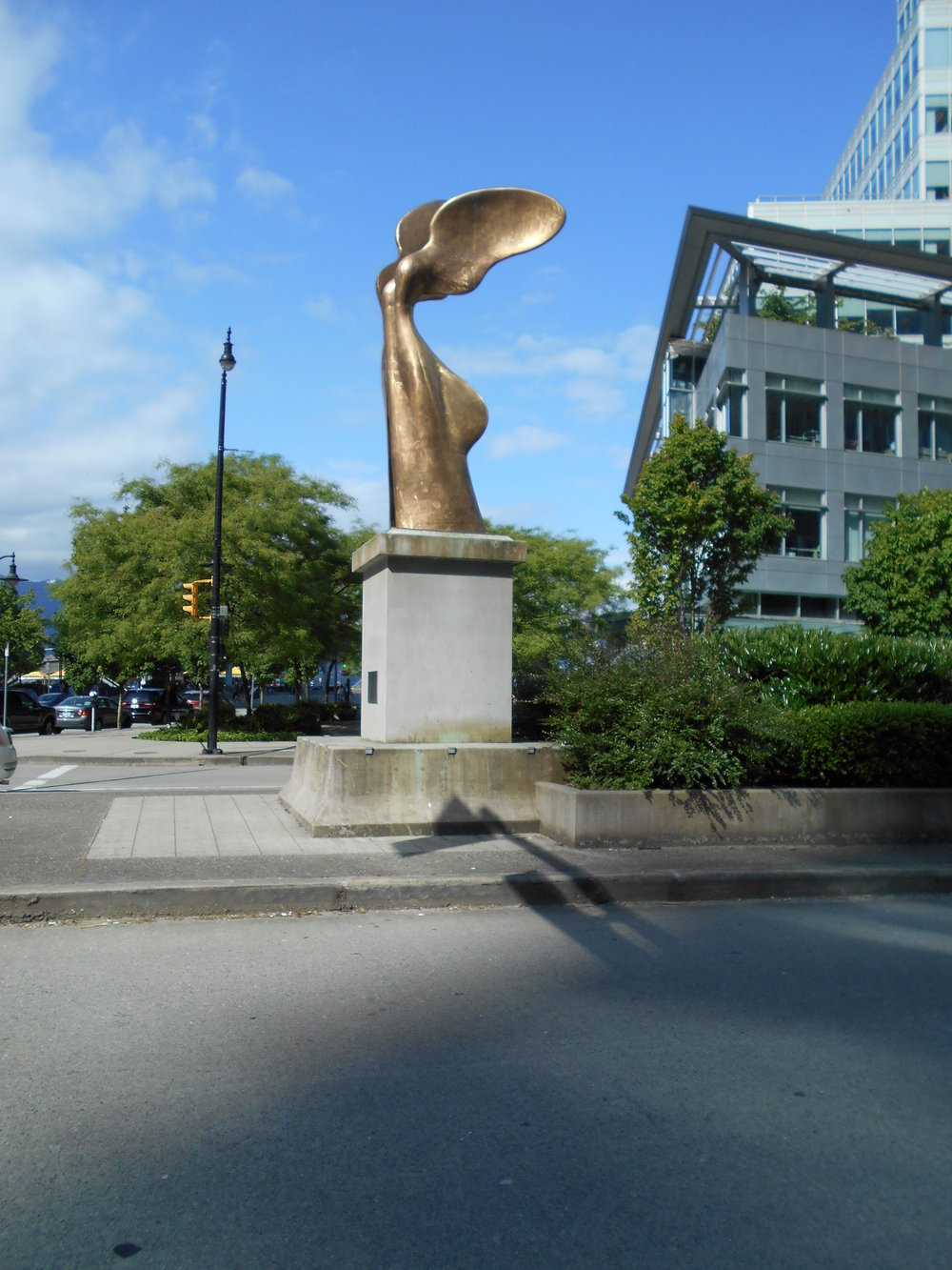 Nike, Greek Goddess of Victory, rises over Cordova Street.