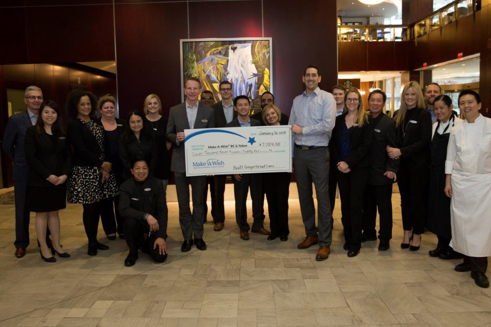 The Hyatt team presenting a cheque for $7,724.80 to the Make A Wish Foundation.