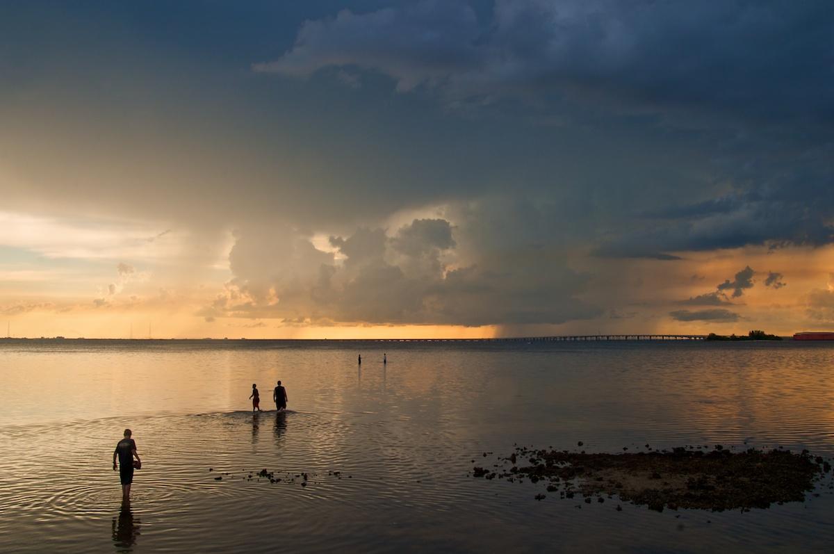 Boys walking into Tampa Bay. Florida. © Jeremy Allen