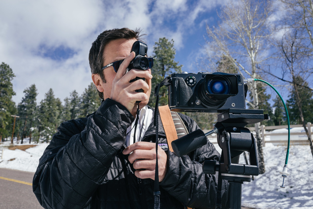 Joseph Gamble metering the scene before making a panoramic image with the Hasselblad Xpan film camera. Here he used the Zone System to meter for the snow and then opened the aperture 2.5 stops to achieve the exposure he wanted. May 11, 2015.