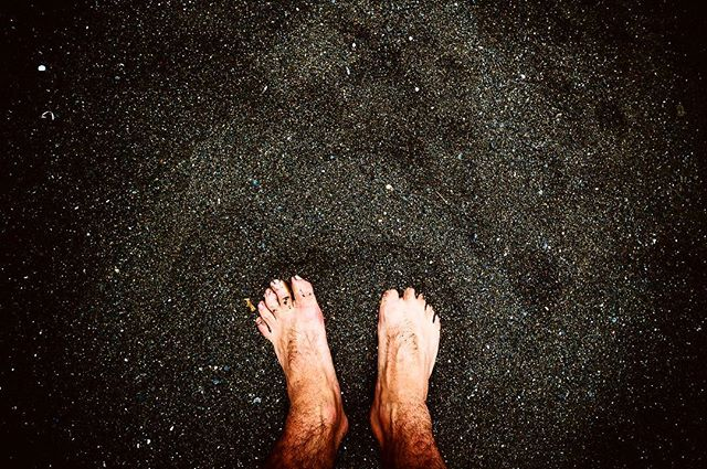 toes in the black sand beaches.