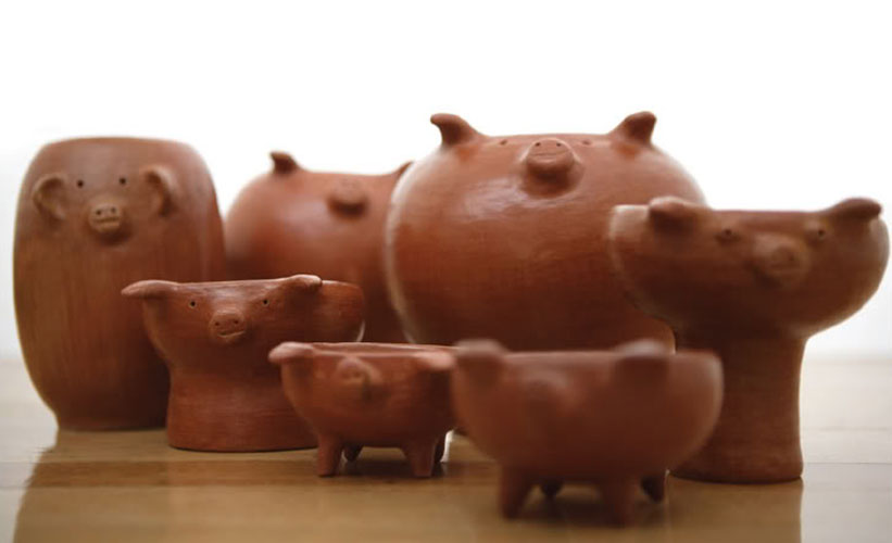 A family of pig cups, bowls and jugs made with red clay fromSan Marcos Tlapazola, Oaxaca