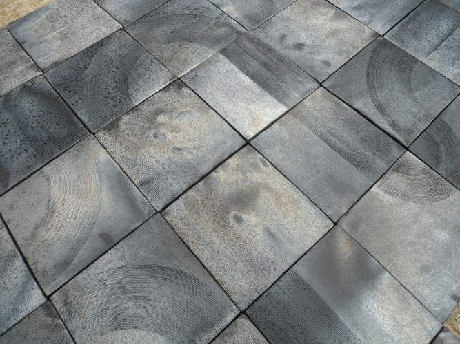 These black-clay wall tiles from San Bartolo Coyotepecwould look incredible in a kitchen or bathroom.