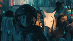 Photo of female riot cop and horse in night lighting.