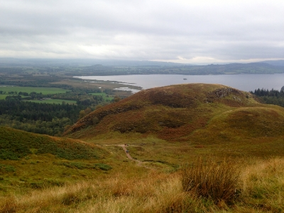 View of the trail on Conic Hill and hikers making the climb.