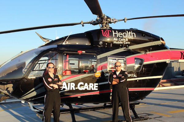 Dr. Steuerwald and Dr. Gerecht in front of Air Care 1 at UCMC