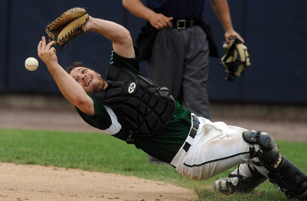 Norwalk's Kevin Daniele misses the ball as he leans backwards to try to catch it during Thursday's FCIAC semifinal game at the Arena at Harbor Yard on May 26, 2011.