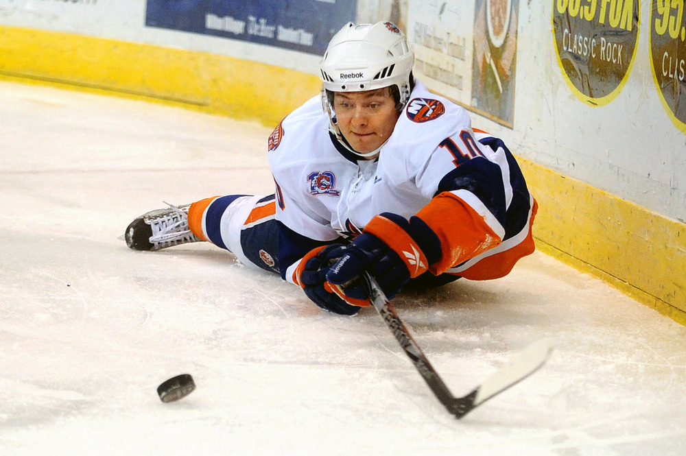 The Soundtigers' Rhett Rakhshani reaches for the puck after falling during Friday's game against the Hartford Wolf Pack at the Arena at Harbor Yard November 26, 2010.