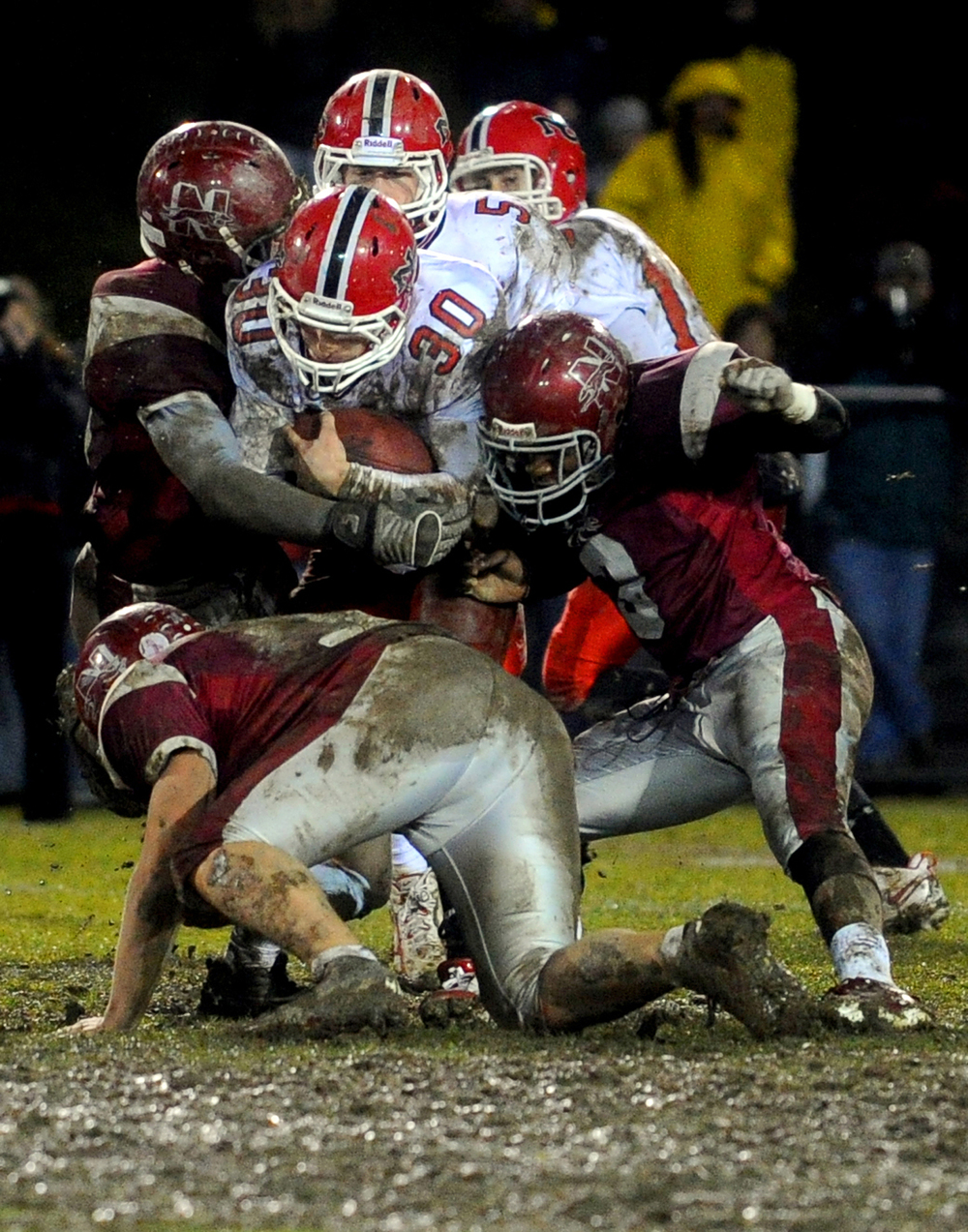 New Canaan's Conor Goodwin is tackled during Tuesday's Class L quarterfinal game at Naugatuck High School on November 30, 2010.