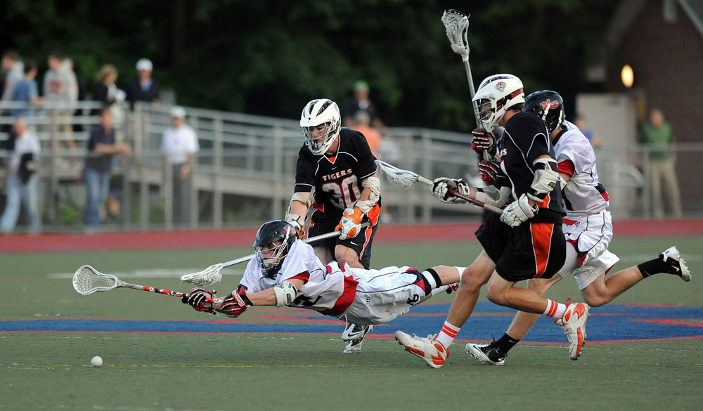 New Canaan's Robert Distler dives for the ball during Friday's FCIAC boys lacrosse championship game at Brien McMahon High School in Norwalk on May 25, 2012.