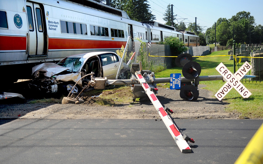 Police and MTA employees work at Camp Ave. near Hoyt Street after the driver of a sedan collided with a Metro-North train August 17, 2011.