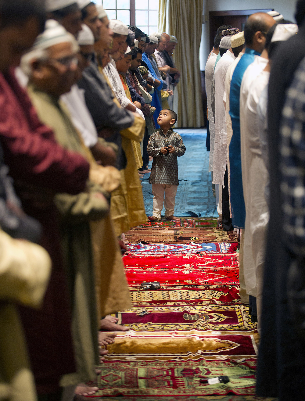 Members of the Stamford Islamic Center participate in Eid al-Fitr prayers to mark the end of Ramadan at the Italian Center in Stamford, Conn., on Thursday, August 8, 2013.