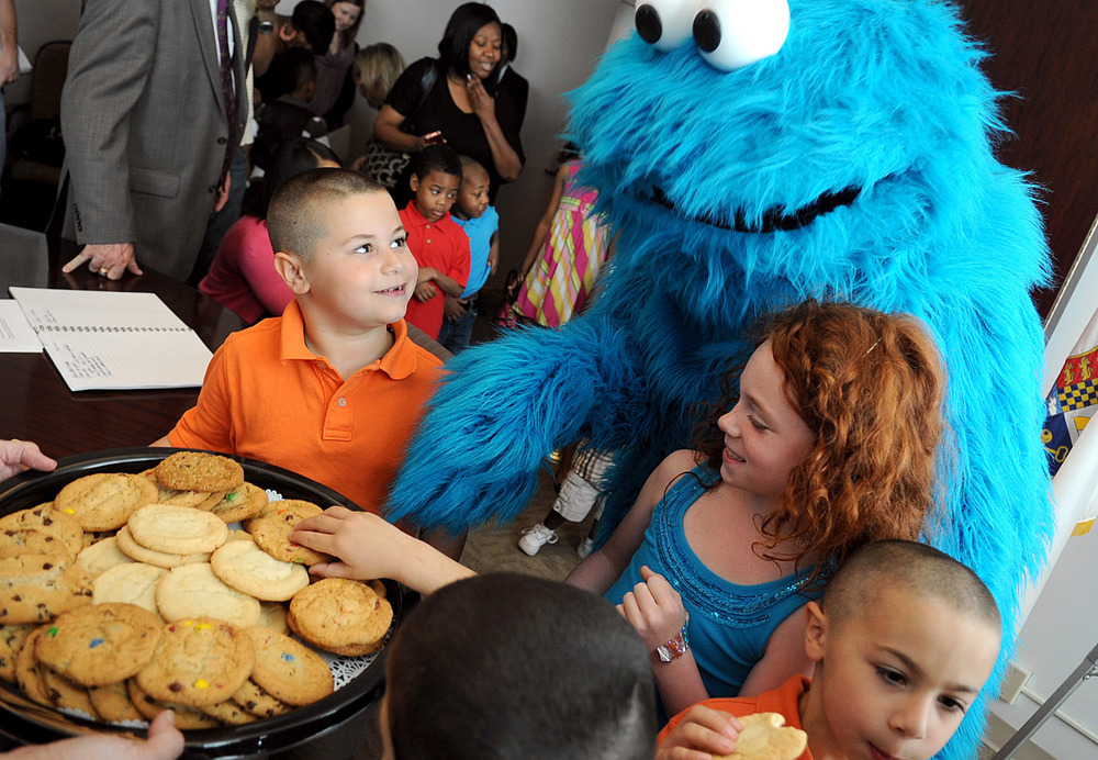 "Cookie Monster reaches for a plate of cookies after Stamford Mayor Michael Pavia proclaimed April 17, 2012, ""Sesame Street Live Day"" in advance of three perfomances at The Palace Theatre."