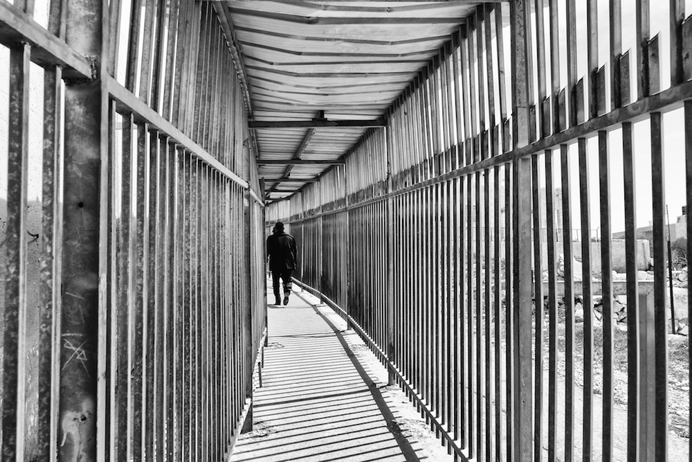 A man walks through the designated passageway for Palestinians at the Bethlehem checkpoint