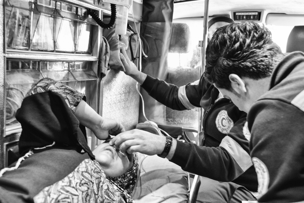A woman is treated for severe teargas inhalation in an ambulance