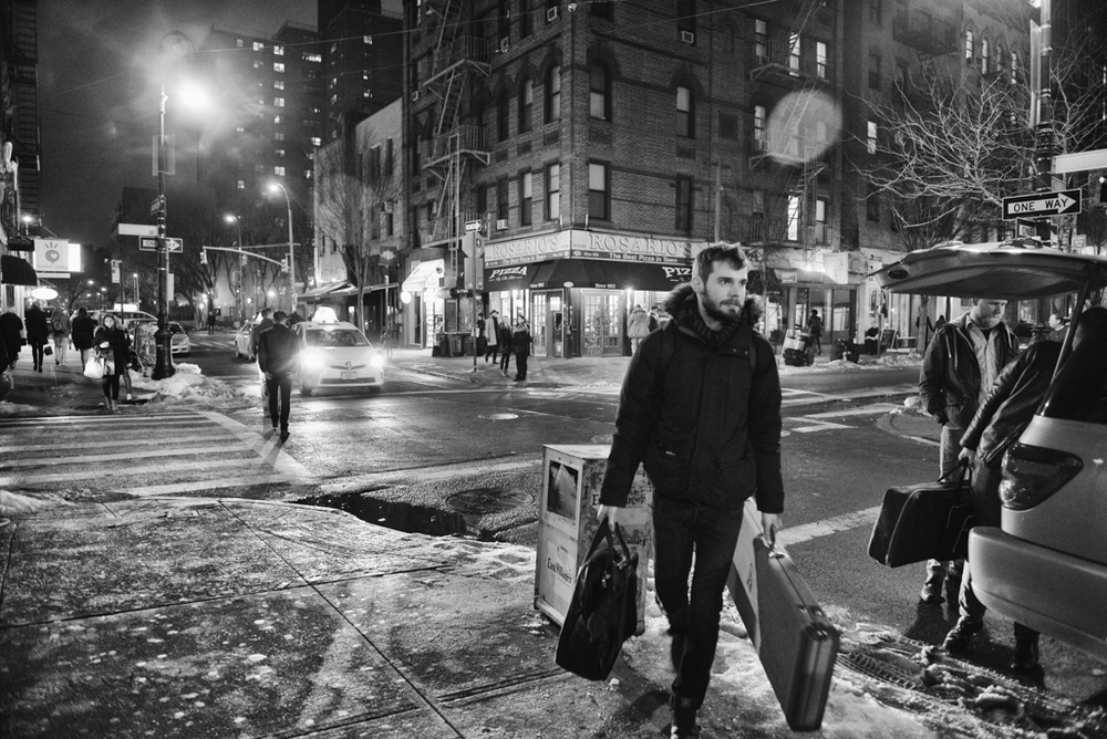 Tom Barnes of Slush & Lean carries instruments and gear to a show on the Lower East Side of Manhattan