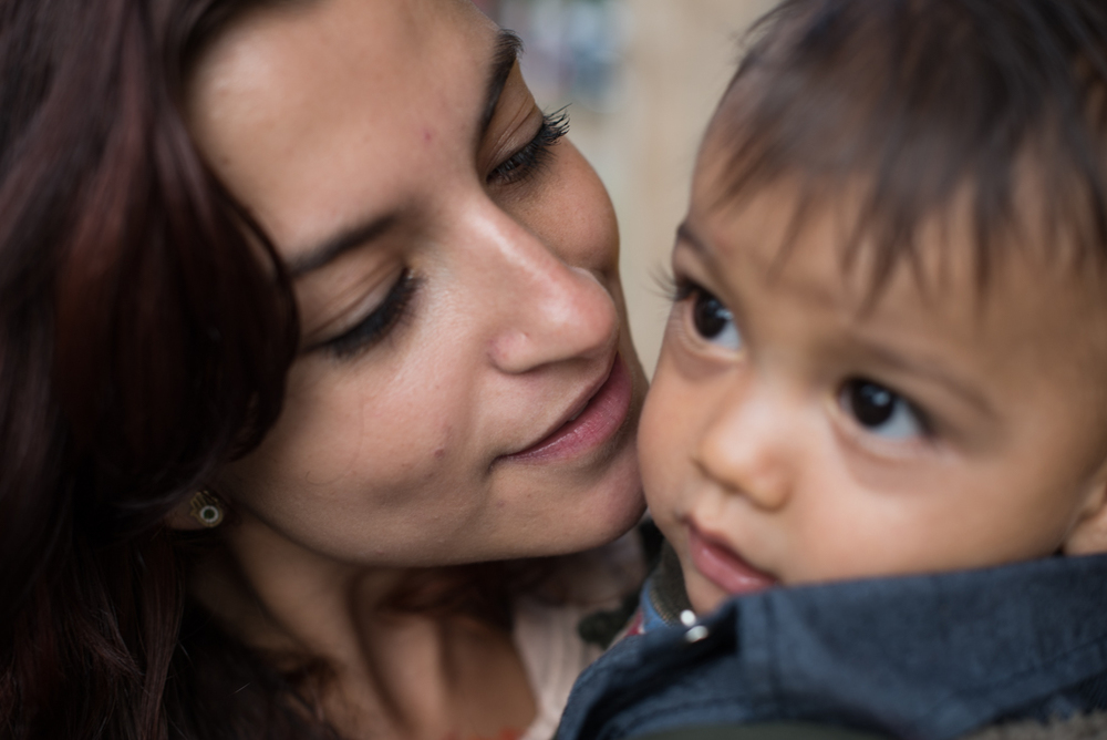 "Maria, 28, with her son Abraham, 9 months. Maria did not plan on having a child, and at first the news was the end of her world, but now she calls him ""the love her of life."" She had to sacrifice dreams of work and travel, but she says wouldn't go back and change a thing."