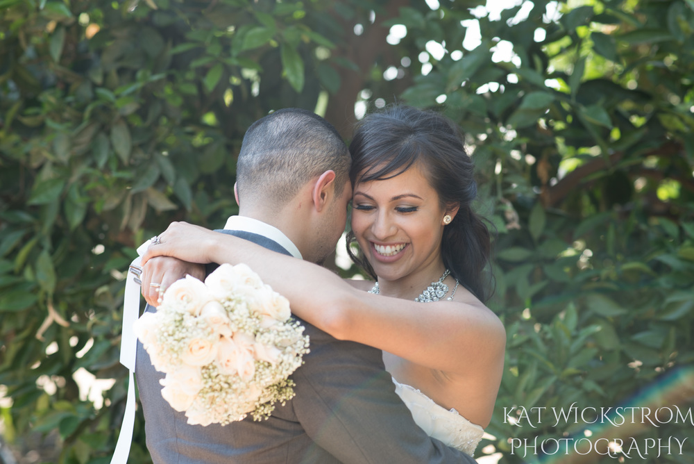 outdoor grove wedding with bride and groom