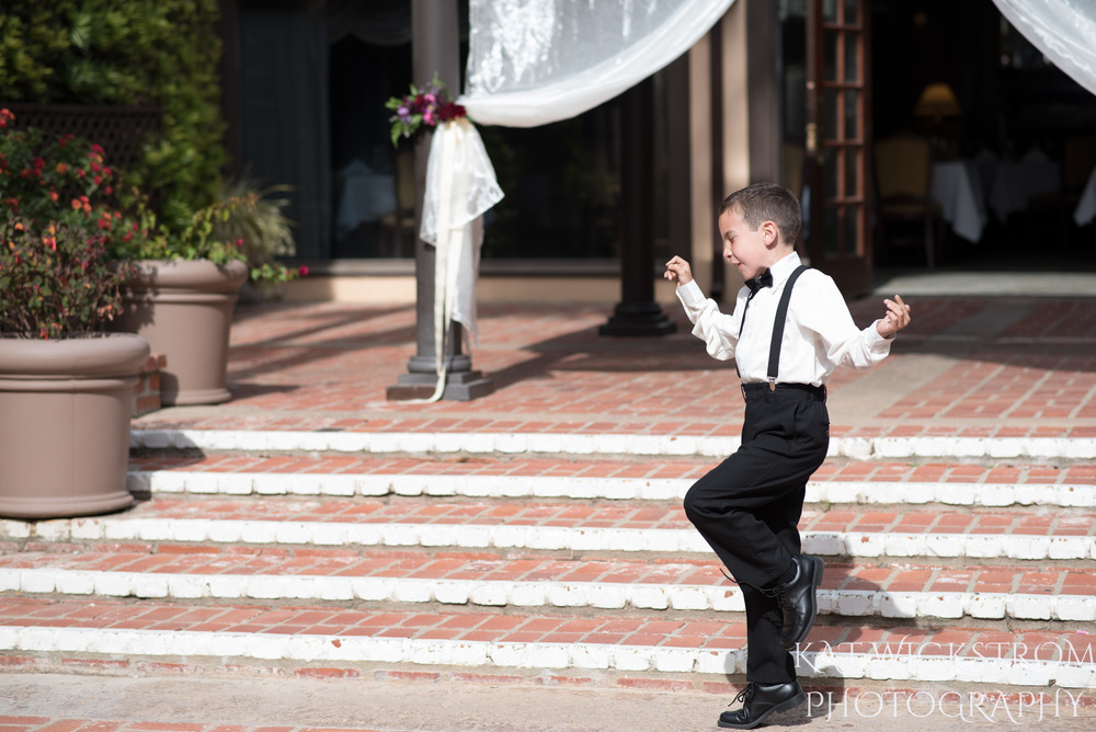 ring bearer dancing at wedding ceremony