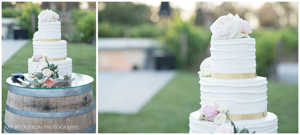 How cute is this wedding cake on a wine barrel?