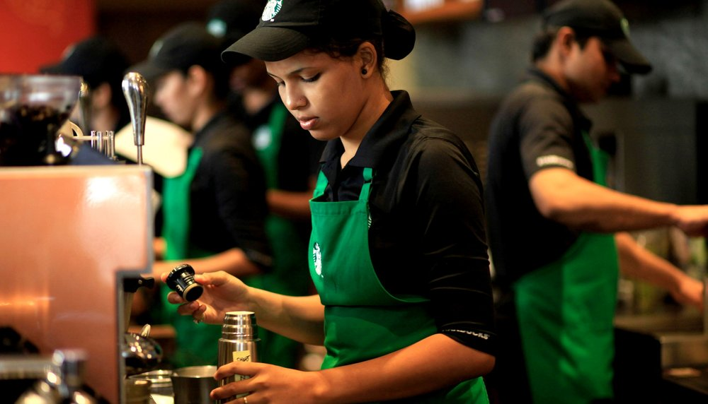 Employees_work_inside_the_Starbucks_at_the_Taj_Mahal_Palace_hotel_in_south_Mumbai%2C_India.jpg