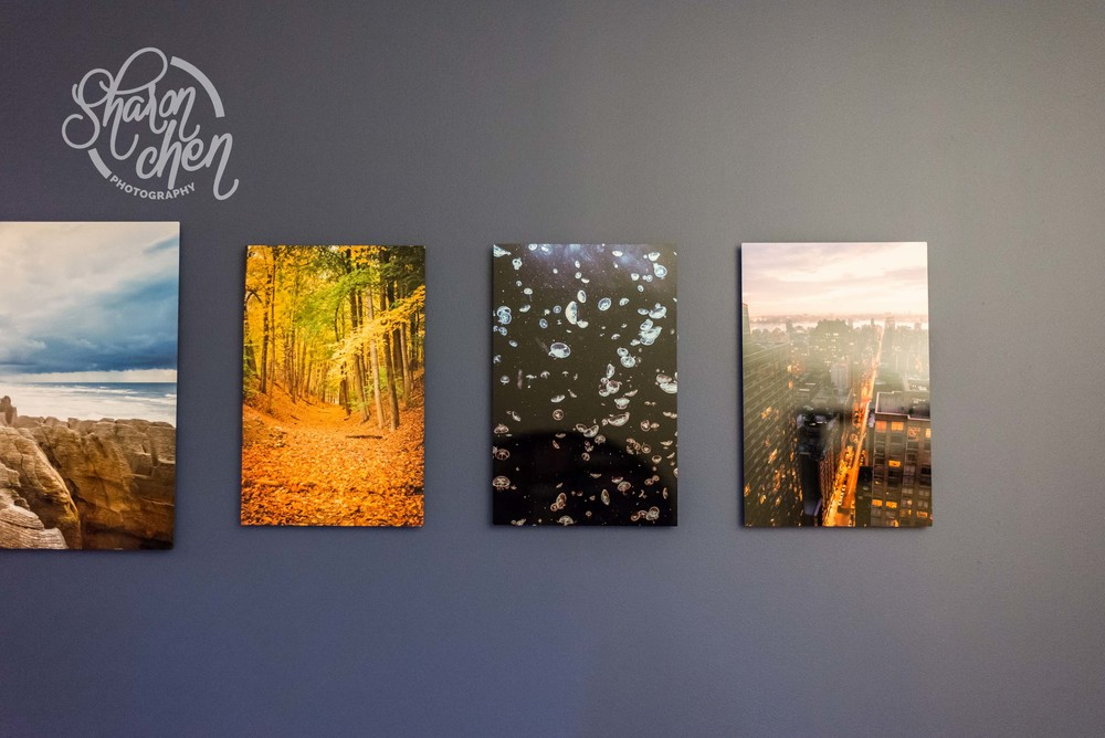 Metal prints on one of my walls at home.