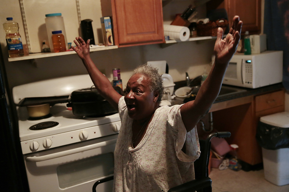 Rhonda Marshall, 59, tells her friend about her problems trying to have management fix a broken lock on her front door in her apartment in the Hacienda housing complex in Richmond, California, Friday, February 6, 2015. She has had moving boxes packed with her belongings for more than a year as she anticipated a voucher allowing her to relocate from the Hacienda housing complex. Today it was announced that current residents of the Richmond Housing Authority owned and maintained complex would receive Section 8 vouchers to find housing as the housing complex is renovated and long-standing problems with the building are addressed.
