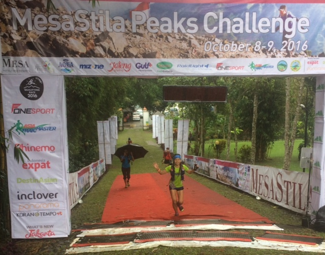 Jessica Lintanga arrives to win the women's 4 Peaks race in another downpour