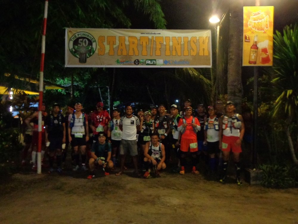 The start of the race at night with race director Doi Calbes in the middle