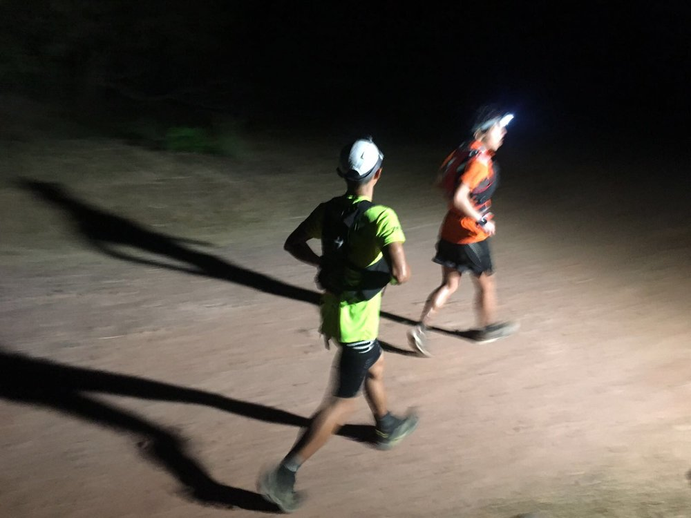 Steven Oong catches a dehydrated Wataru Iino just before the final checkpoint